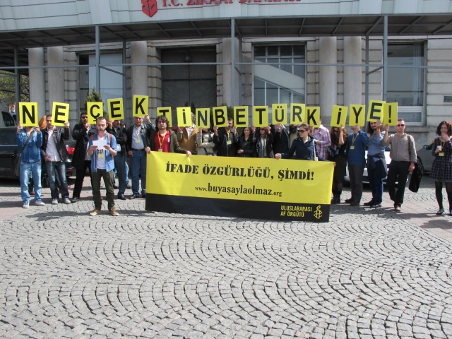 Amnesty activists in Istanbul staging protest on April 6, 2013