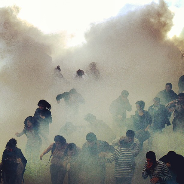 May Day, 2013.  Protestors fleeing tear gas. Photograph by Burak Kara.  Used with Permission