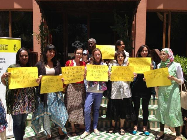 Amnesty staff and volunteers from the International Women's Human Rights Network take a stand against police violence in Turkey