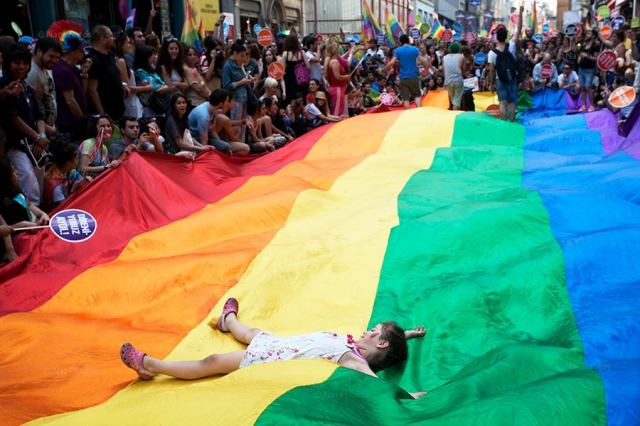After a month of protests, the 11th gay pride march as thousands of gay rights activists as well as demonstrators who participated in Gezi Park gatherings marched on the İstiklal Avenue, Taksim. Rainbow flags and banners supporting peace in Turkish, Kurdish, Armenian and Arabic were displayed.© Gülşin Ketenci/NarPhotos