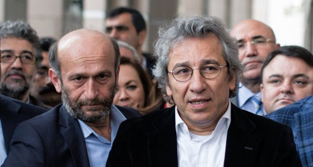 Can Dundar, the editor-in-chief of opposition newspaper Cumhuriyet, right, and Erdem Gul, the paper's Ankara representative, left, speak to the media outside a courthouse in Istanbul, Turkey, Thursday, Nov. 26, 2015.  Turkey's Anadolu state-run news agency says a prosecutor has demanded that Dundar and Gul be jailed on charges of terror propaganda and for revealing state secrets, when the Cumhuriyet paper published what it said were images of Turkish trucks carrying ammunition to Syrian militants. (AP Photo/Vedat Arik, Cumhuriyet)