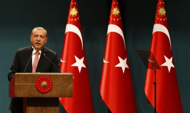 Turkish President Tayyip Erdogan speaks during a news conference at the Presidential Palace in Ankara