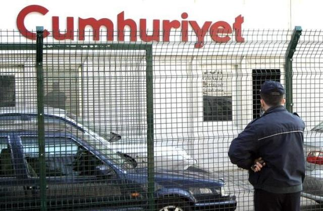 Police officer stands outside the office of Turkish daily