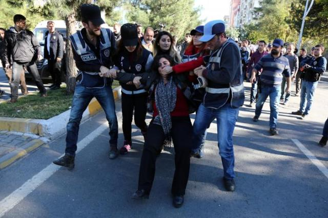 Police detain DBP co-chair Tuncel during a protest against the arrest of Kurdish lawmakers, in Diyarbakir